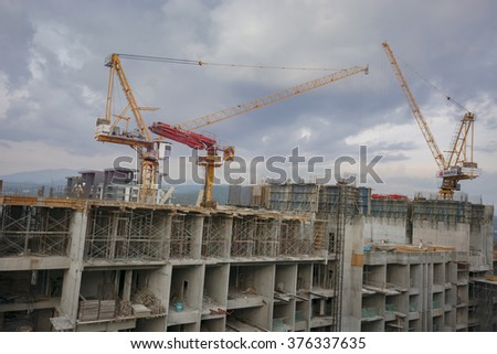 KUALA LUMPUR, MALAYSIA - FEBRUARY 13, 2016. A red and yellow building construction crane on a redevelopment site in the Ampang area of Kuala Lumpur, Malaysia.