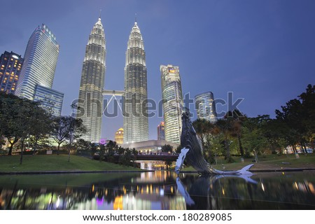 KUALA LUMPUR, MALAYSIA - FEBRUARY 7, 2014 - Kuala Lumpur KLCC Park Skyline with Twin Towers Petronas. They are the tallest buildings in the world from 1998 to 2004 until surpassed by Taipei 101. - stock photo