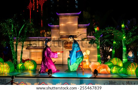 KUALA LUMPUR, MALAYSIA - FEBRUARY 23, 2015: Lighted lanterns and sculptures of characters from Chinese folklores decorate the grounds of Thean Hou Temple in celebration of the Chinese New Year. - stock photo