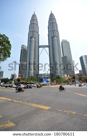 KUALA LUMPUR, MALAYSIA - FEBRUARY 20: Petronas Twin Towers on February 20, 2014 in Kuala Lumpur, Malaysia. Petronas Towers are twin skyscrapers and were tallest buildings in the world until 2004 - stock photo