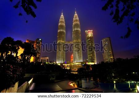 KUALA LUMPUR, MALAYSIA - FEBRUARY 23: Petronas Twin Towers - the tallest twin buildings in the world at the night February 23 - 2009, Kuala Lumpur, Malaysia - stock photo