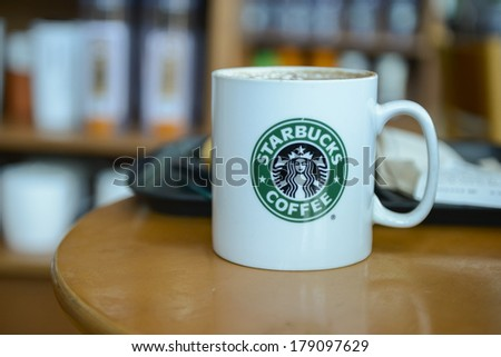 KUALA LUMPUR,MALAYSIA-FEBRUARY 28, 2014:Picture of cocoa cappuccino in a hot steamy mug in Kuala Lumpur. Starbucks Malaysia franchise is owned by Berjaya Group Berhad company - stock photo
