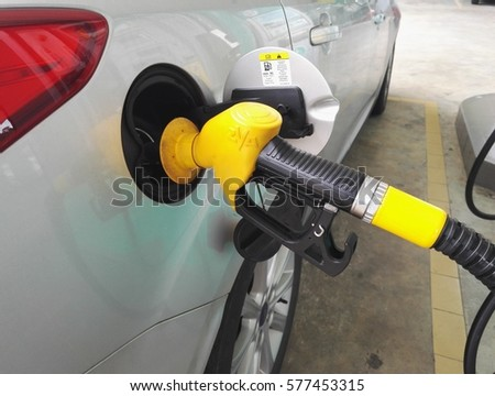 KUALA LUMPUR, MALAYSIA - FEBUARY 13TH, 2017 : Car owner in Malaysia fill-up fuel RON95. Malaysia offer option for the consumers which is RON 95 and RON 97 currently.