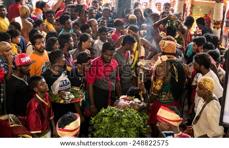 KUALA LUMPUR, MALAYSIA - JANUARY 31, 2015: Hindu devotees perform prayers at the Sri Mahamarriamman temple inside Batu Caves. Hundreds of thousands of devotees come here for the Thaipusam prayers. - stock photo