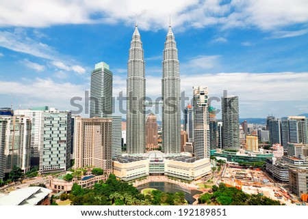 KUALA LUMPUR, MALAYSIA - JANUARY 19: Petronas Twin Towers at day on January 19, 2014 in Kuala Lumpur. Petronas Twin Towers were the tallest buildings (452 m) in the world from 1998 to 2004 - stock photo