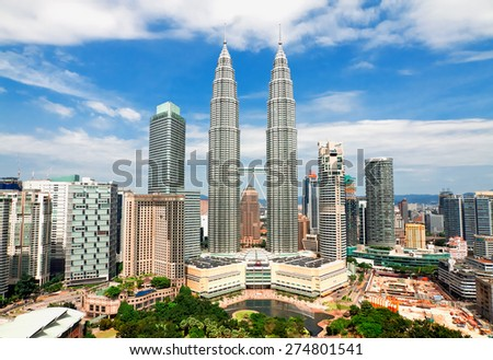 KUALA LUMPUR, MALAYSIA - JANUARY 19: Petronas Twin Towers at day on January 19, 2014 in Kuala Lumpur. Petronas Twin Towers were the tallest buildings (452 m) in the world from 1998 to 2004