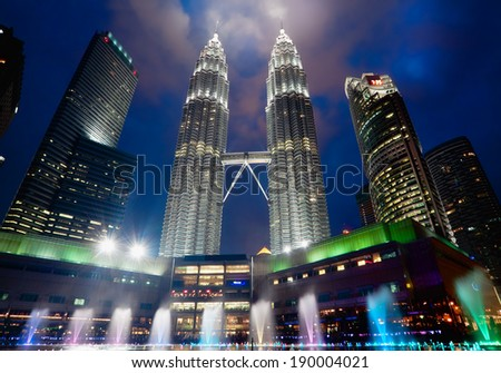 KUALA LUMPUR, MALAYSIA - JANUARY 9: Petronas Twin Towers at day on January 9, 2014 in Kuala Lumpur. Petronas Twin Towers were the tallest buildings (452 m) in the world from 1998 to 2004 - stock photo