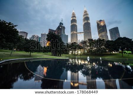 KUALA LUMPUR, MALAYSIA - JANUARY 22: Petronas Twin Towers - tallest twin buildings in the world at the night January 22, 2011. Kuala Lumpur, Malaysia - stock photo