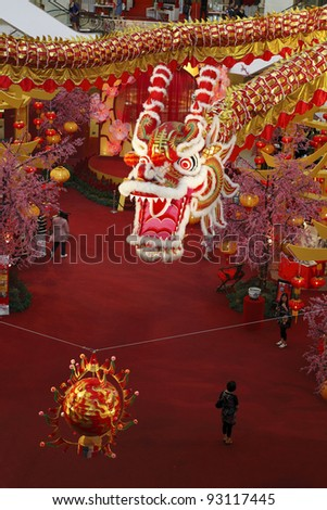 KUALA LUMPUR, MALAYSIA - JANUARY 17: The giant 600ft long Majestic Dragon hanging above centre court in Pavilion KL on January 17, 2012 in Kuala Lumpur, Malaysia. It signifying power, wealth and luck.