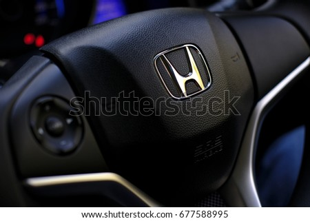 Kuala Lumpur, Malaysia - July 15, 2017 : Honda Black Steering Wheel And Silver Logo. Honda Motor Co., Ltd. is a Japanese public multinational conglomerate corporation.