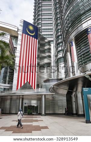 KUALA LUMPUR, MALAYSIA - JULY 06, 2009: Large Malaysian flag on Petronas Twin Towers facade. - stock photo