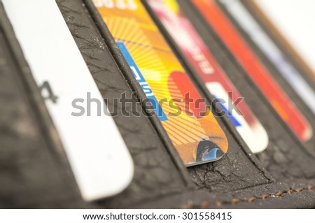 KUALA LUMPUR, MALAYSIA - JULY 30th 2015. Multiple card inside the wallet. Having more cards means you have to work harder to manage them. - stock photo