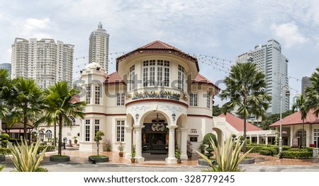 KUALA LUMPUR, MALAYSIA - JULY 06, 2009: View on Malaysia Tourism Centre (MaTiC). It is architectural and historical landmark of Kuala Lumpur. Built in 1935. Panoramic montage from 5 images. - stock photo