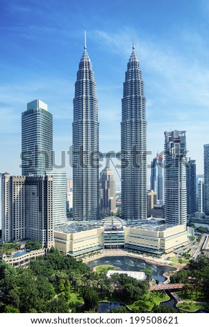 KUALA LUMPUR, MALAYSIA - JUN 12: Petronas Twin Towers and KLCC park  on Jun 12, 2014 in Kuala Lumpur.  Petronas Twin Towers were the tallest buildings in the world from 1998 to 2004.