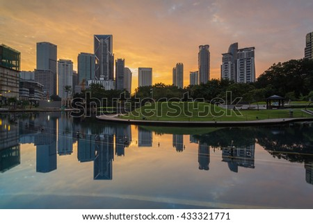 KUALA LUMPUR,MALAYSIA-JUNE 5 2016:Commercial buildings views from Symphony Lake KLCC during the last sunrise day before ramadan month.The image may contain noise and softness due to long exposure