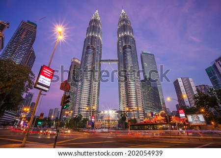 KUALA LUMPUR, MALAYSIA - JUNE 25: Petronas Twin Towers at night on JUNE 25, 2014 in Kuala Lumpur. They were the tallest building in the world 1998-2004 and remain the tallest twin building  - stock photo