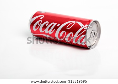 KUALA LUMPUR, MALAYSIA - JUNE 5, 2015 : The screen on Coca Cola can to 100 years celebration of Coca Cola glass bottle. Coca-Cola is the most popular favorite carbonated beverages.
