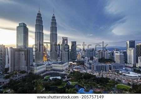 KUALA LUMPUR, MALAYSIA - June 6:  View of the Petronas Towers on June 6, 2014 in Kuala Lumpur.  The towers are the tallest twin buildings in the world. - stock photo