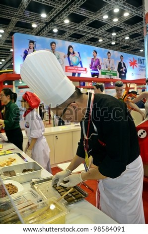 KUALA LUMPUR, MALAYSIA - MARCH 17: An unidentified chef University of USCI at  exhibition during the Falcon Education Fair 2012 at Kuala Lumpur Convention Centre (KLCC) March 17, 2010 in Kuala Lumpur. - stock photo