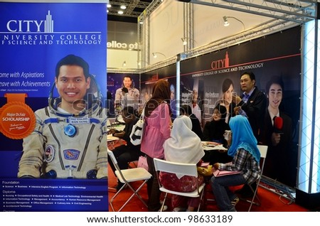 KUALA LUMPUR, MALAYSIA - MARCH 17: City University College promote the exhibition during the Falcon Education Fair 2012 at Kuala Lumpur Convention Centre (KLCC) March 17, 2012 in Kuala Lumpur. - stock photo