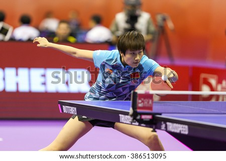 KUALA LUMPUR, MALAYSIA - MARCH 01, 2016: Ding Ning of China plays a return shot in her match in the Perfect 2016 World Team Table-tennis Championships held in Kuala Lumpur, Malaysia. - stock photo