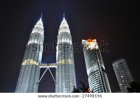 KUALA LUMPUR,MALAYSIA - MARCH 28: Earth Hour - Light On at Petronas Twin Tower on March 28, 2009. It is organized by WWF aims to raise awareness towards the need to take action on climate change.