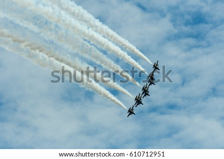 KUALA LUMPUR, MALAYSIA - March 29, 2017 : Jet fighter of BLACK EAGLES T-50 owned by The Republic of Korea Air Force flypast over the capital today.  Black Eagles aerobatic team of the republic