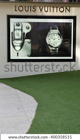 KUALA LUMPUR, MALAYSIA - March 31, 2016. Louis Vuitton advertising board display on wall in Kuala Lumpur. Louis Vuitton is a France luxury leather goods company. Founded in Paris, France since 1854. - stock photo