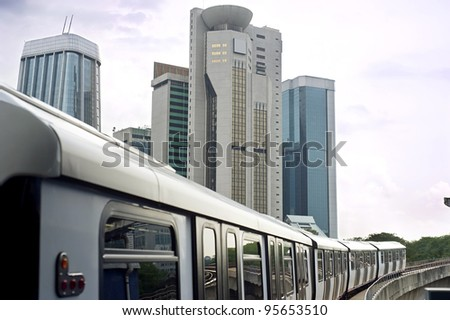KUALA LUMPUR, MALAYSIA - MARCH 16: LRT train arrives at a train station on March 16, 2011 in Kuala Lumpur. Kuala Lumpur metro or rapid transit system consists of 6 metro lines operated by 4 operators. - stock photo