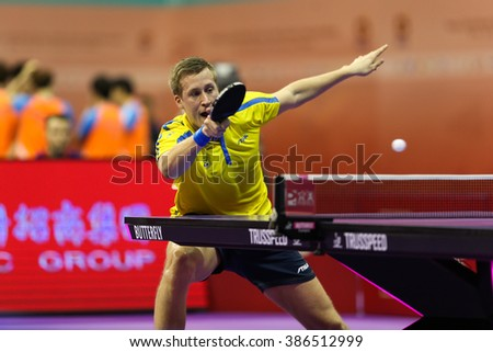 KUALA LUMPUR, MALAYSIA - MARCH 01, 2016: Mattias Karlsson of Sweden plays a return shot in his match in the Perfect 2016 World Team Table-tennis Championships held in Kuala Lumpur, Malaysia.