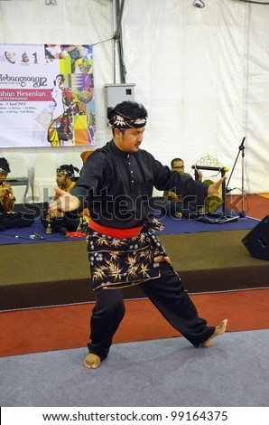 KUALA LUMPUR, MALAYSIA - MARCH 30: Performing martial arts skills by exhibitors during the exhibition at the National Craft Day 2012 at the Kuala Lumpur Craft Complex on March 30,2012 in Kuala Lumpur - stock photo