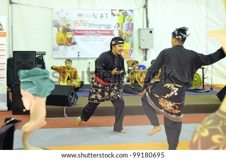 KUALA LUMPUR, MALAYSIA - MARCH 30: Performing martial arts skills by exhibitors during the exhibition at the National Craft Day 2012 at the Kuala Lumpur Craft Complex on March 30, 2012 in Kuala Lumpur - stock photo