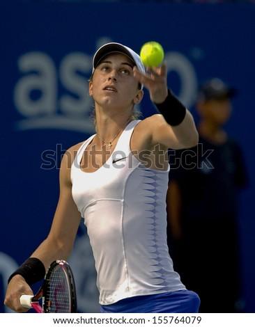 Kuala Lumpur, Malaysia, March 04, 2013: Petra Martic of Croatia  serves during the WTA Malaysian Open tennis tournament. - stock photo