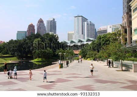 KUALA LUMPUR, MALAYSIA - MARCH 28: Tourists stroll on March 28, 2008 in Kuala Lumpur, Malaysia. In 2010 Kuala Lumpur was the 6th most visited city worldwide with 8.9m international visitors. - stock photo