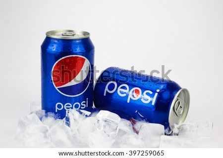KUALA LUMPUR, MALAYSIA - March 26, 2016. Two Pepsi Cans with ice Isolated On White  - stock photo