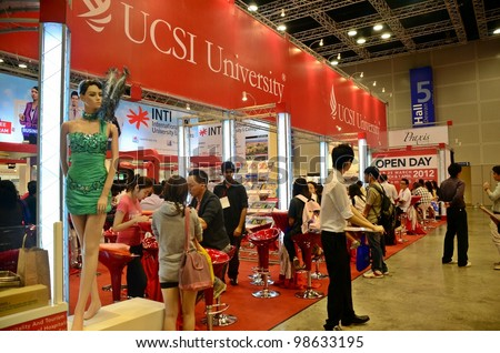 KUALA LUMPUR, MALAYSIA - MARCH 17: UCSI University promote the exhibition during the Falcon Education Fair 2012 at Kuala Lumpur Convention Centre (KLCC) March 17, 2012 in Kuala Lumpur. - stock photo