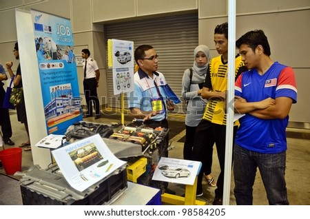 KUALA LUMPUR, MALAYSIA - MARCH 17: Vocational Education promote the exhibition during the Falcon Education Fair 2012 at Kuala Lumpur Convention Centre (KLCC) March 17, 2010 in Kuala Lumpur. - stock photo