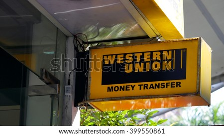 KUALA LUMPUR, MALAYSIA - March 31, 2016. Western Union sign display on wall in center of Kuala Lumpur. Western Union is a wire transfers money company, Founded in New York, USA since 1851. - stock photo