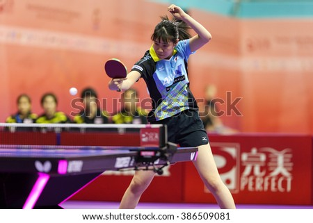 KUALA LUMPUR, MALAYSIA - MARCH 01, 2016:Yui Hamamoto of Japan plays return shot in her match in the Perfect 2016 World Team Table-tennis Championships held in Kuala Lumpur, Malaysia. - stock photo