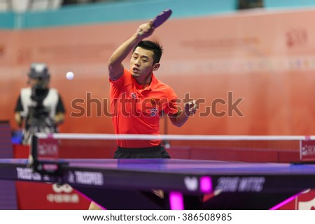 KUALA LUMPUR, MALAYSIA - MARCH 01, 2016: Zhang Jike of China plays return shot in his match in the Perfect 2016 World Team Table-tennis Championships held in Kuala Lumpur, Malaysia. - stock photo