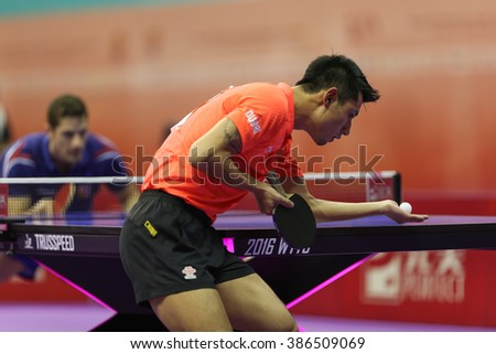 KUALA LUMPUR, MALAYSIA - MARCH 01, 2016: Zhang Jike of China serves the ball in his match in the Perfect 2016 World Team Table-tennis Championships held in Kuala Lumpur, Malaysia. - stock photo