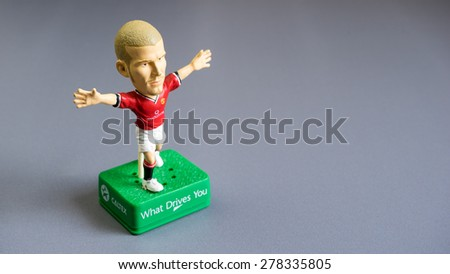 Kuala Lumpur, Malaysia - May 16, 2015: A studio shot of David Beckham toy figure, from Caltex petrol station promo. Beckham is a former professional footballer who played for Manchester United - stock photo