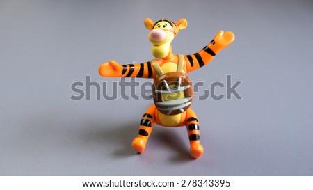 Kuala Lumpur, Malaysia - May 16, 2015: A studio shot of Tigger character figure. Tigger is a fictional tiger character originally introduced in A. A. Milnes book The House at Pooh Corner - stock photo