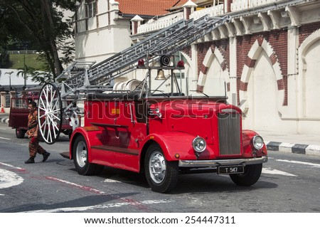 KUALA LUMPUR, MALAYSIA - MAY 2, 2014: Fire engine and firefighter during the Fire Fighters Day celebrations at Dataran Merdeka.