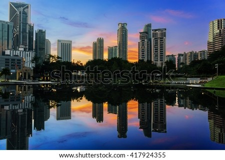 KUALA LUMPUR, MALAYSIA - MAY 07, 2016 : KLCC Lake Symphony views and reflection during sunrise. Layers and clipping path provided