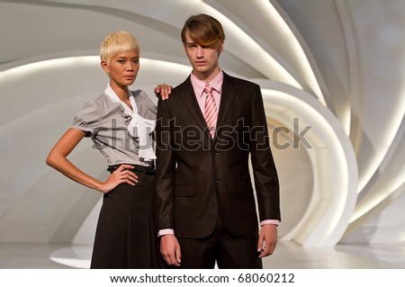 KUALA LUMPUR, MALAYSIA - MAY 8: models poses an outfit during License To Styles fashion show on May 8, 2010 in Kuala Lumpur Malaysia - stock photo