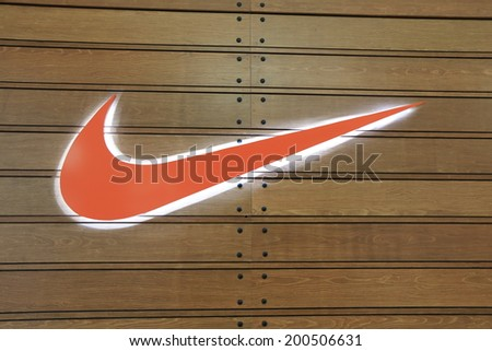 KUALA LUMPUR MALAYSIA - 25 May, 2014:NIKE logo. Nike is an American multinational corporation manufacturing footwear, apparel, equipment and accessories.  - stock photo