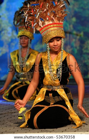 KUALA LUMPUR, MALAYSIA - MAY 21 : Participants perform a dance during the rehearsal of Colours of Malaysia Festival May 21, 2010 in Kuala Lumpur Malaysia. - stock photo
