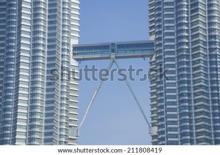KUALA LUMPUR, MALAYSIA -MAY 11: Petronas Twin Towers at day on May 11, 2014 in Kuala Lumpur. Petronas Twin Towers were the tallest buildings (452 m) in the world from 1998 to 2004 - stock photo