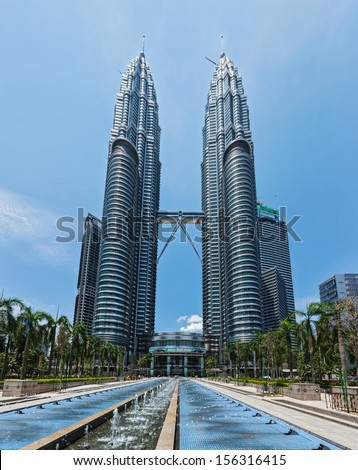 KUALA LUMPUR, MALAYSIA - MAY 5: Petronas Twin Towers in twilight on May 5, 2011 in Kuala Lumpur. They were the tallest building in the world 1998-2004 and remain the tallest twin building - stock photo